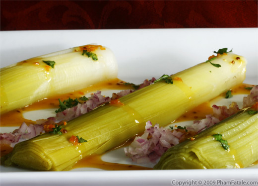 Leeks served with a Kumquat Clementine Vinaigrette